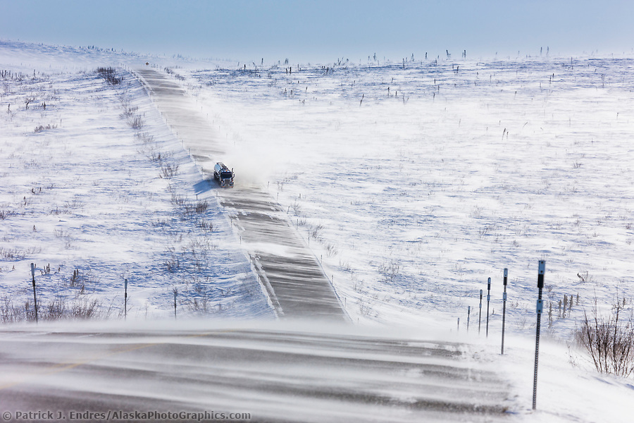 """Dalton Highway photos: Blowing snow across the James Dalton Highway near Finger Mountain, a notoriously winder area along the """"Haul Road"""" that leads from Fairbanks to Prudhoe Bay, Alaska. (Patrick J Endres / AlaskaPhotoGraphics.com)"""