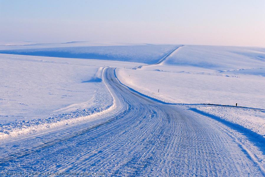 Dalton Highway photos: Ice covered James Dalton Highway (Haul Road) stretches across the snow covered Arctic coastal plains of Alaska. (Patrick J. Endres / AlaskaPhotoGraphics.com)