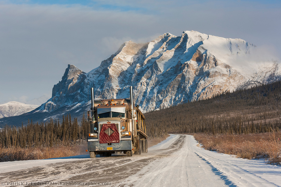 Dalton Highway photos: Semi tractor trailer travels the James Dalton Highway (the haul road) with mt Sukakpak rising in the distance. (Patrick J Endres / AlaskaPhotoGraphics.com)